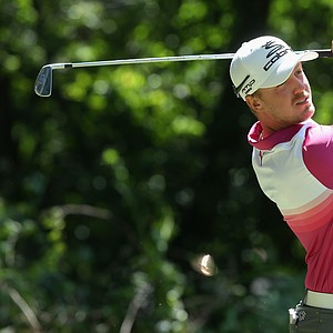 Jonas Blixt watches his tee shot on the third hole during the third round of the 95th PGA Championship.