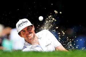 Keegan Bradley plays a bunker shot on the eighth hole during the third round of the 95th PGA Championship.