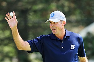 Matt Kuchar celebrates after a birdie putt on the first green during the third round of the 95th PGA Championship.