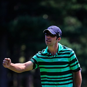 Paul Casey celebrates a birdie putt on the third green during the third round of the 95th PGA Championship.