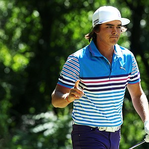 Rickie Fowler waves as he walks off the third tee during the third round of the 95th PGA Championship.