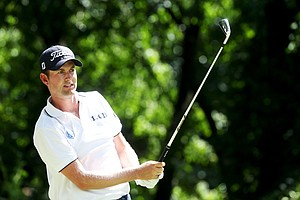 Webb Simpson hits his tee shot on the third hole during the third round of the 95th PGA Championship.