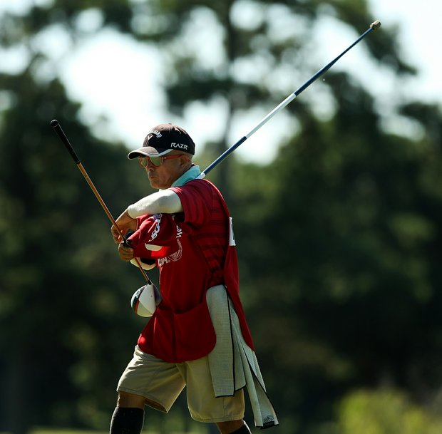Delin Feng caddied for his daughter, Yueer Cindy Feng, during the final round of match play at the 2013 U. S. Women's Amateur at Country Club of Charleston.