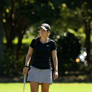 Emma Talley watches the putt of Yueer Cindy Feng at No. 13 during the first 18 holes of the final round of match play at the 2013 U. S. Women's Amateur at Country Club of Charleston.