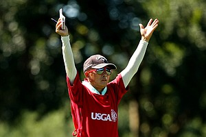 Delin Feng signals to his daughter, Yueer Cindy Feng, for the direction of her shot during the final round of match play at the 2013 U. S. Women's Amateur.