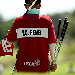 Delin Feng, caddied for his daughter, Yueer Cindy Feng, during the final round of match play at the 2013 U. S. Women's Amateur at Country Club of Charleston.
