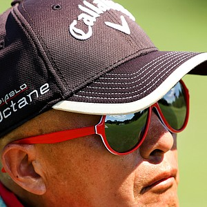 Delin Feng, Yueer Cindy Feng's dad, was caddy for the week, wearing his red sunglasses at the 2013 U. S. Women's Amateur.