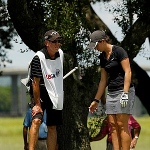 Emma Talley and her dad, Dan, discuss a shot during the final round of match play at the 2013 U. S. Women's Amateur at Country Club of Charleston.
