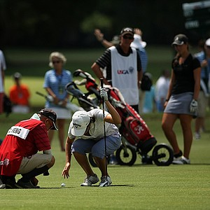 Yueer Cindy Feng and her dad/caddie, Delin Feng, try to get something off the ball during the final round of match play at the 2013 U. S. Women's Amateur at Country Club of Charleston.
