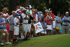 Spectators watch the action from the 11th green during the final round of match play at the 2013 U. S. Women's Amateur at Country Club of Charleston.
