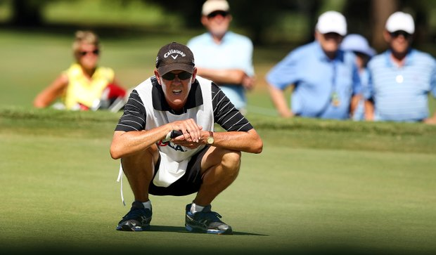 Dan Talley looks over his daughters putt during the final round of match play at the 2013 U. S. Women's Amateur at Country Club of Charleston.