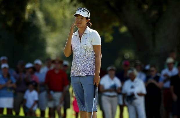 Yueer Cindy Feng reacts to missing her putt at No. 17, the 35th hold, ending the match during the final round of match play at the 2013 U. S. Women's Amateur at Country Club of Charleston.