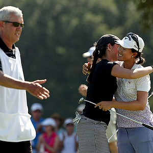 Emma Talley hugs Yueer Cindy Feng after she won 2 and 1 at No. 17, the 35th hole during the final round of match play at the 2013 U. S. Women's Amateur at Country Club of Charleston.