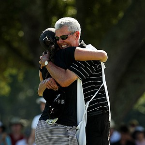 Dan Talley gives his daughter Emma a hug at No. 17, the 35th hole, after she defeated Yueer Cindy Feng 2 and 1, during the 2013 U. S. Women's Amateur at Country Club of Charleston.