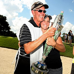 Emma Talley shares the Robert Cox Trophy with her dad, Dan, after she won the 2013 U. S. Women's Amateur at Country Club of Charleston.
