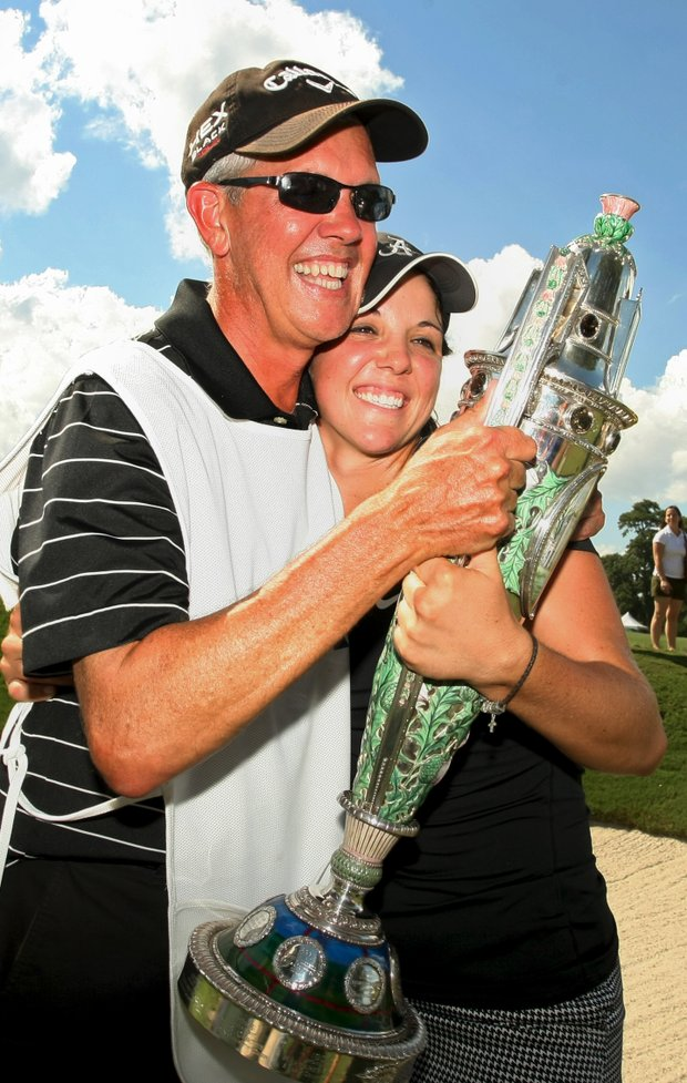 Emma Talley shares the Robert Cox Trophy with her dad who caddied all week after winning the 2013 U. S. Women's Amateur at Country Club of Charleston.