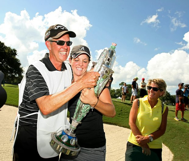 Emma Talley shares the Robert Cox Trophy with her father Dan, who caddied for her all week, at the 2013 U. S. Women's Amateur at Country Club of Charleston.