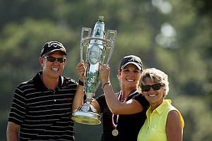 Emma Talley, center, flanked by her parents Dan and Jennifer after winning the 2013 U. S. Women's Amateur at Country Club of Charleston.
