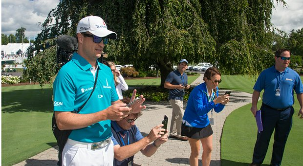 "Zach Johnson stops to take a picture of PGA Championship officials ""Dufnering"" during the 2013 PGA Championship at Oak Hill."
