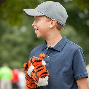 A young Tiger Woods fan watches the 14-time major champ play the final round of the 2013 PGA Championship at Oak Hill.