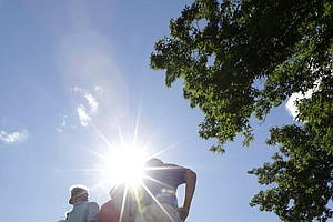 Fans seek a better view during the final round of the 2013 PGA Championship at Oak Hill.