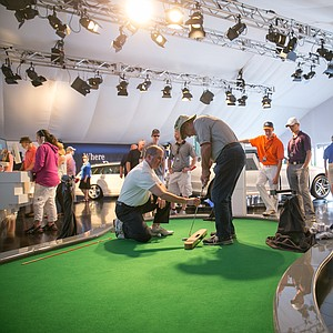 Fans take part in the Mercedes-Benz Performance Center during the final round of the 2013 PGA Championship at Oak Hill.
