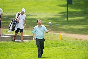 Tim Clark celebrates his hole-in-one during the final round of the 2013 PGA Championship.
