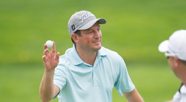 Tim Clark waves after his hole-in-one at Oak Hill's 11th hole during the final round of the 2013 PGA Championship.