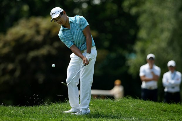 Jim Liu chips at No. 16 during the Round of 64 at the 2013 U. S. Amateur at The Country Club.