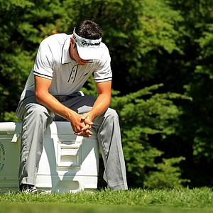 Mario Clemens waits on the tee at No. 12 during the Round of 64 at the 2013 U. S. Amateur at The Country Club. Clemens was sent home by Scott Wolfes.
