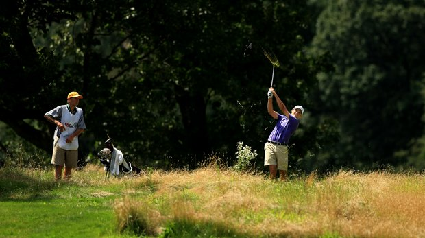 Gavin Hall hits a shot at No. 12 during the Round of 64 at the 2013 U. S. Amateur at The Country Club.