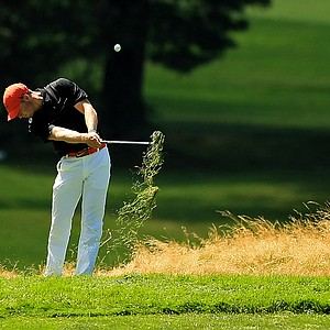Wyndham Clark hits out of the long grass at No. 12 during the Round of 64 at the 2013 U. S. Amateur at The Country Club.