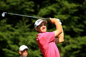 Patrick Rodgers hits his tee shot at No. 12 during the Round of 64 at the 2013 U. S. Amateur at The Country Club.