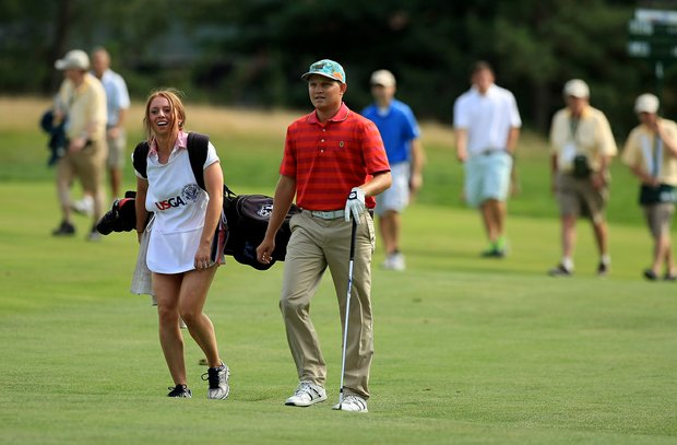 Zac Blair walks with his caddie, Alicia Watkins, during the Round of 64 at the 2013 U. S. Amateur at The Country Club.