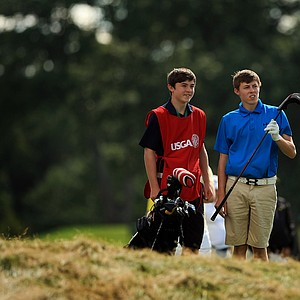 Matt Fitzpatrick with his brother, Alex, as caddie during the Round of 64 at the 2013 U. S. Amateur at The Country Club.