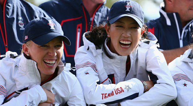 Morgan Pressel (left) and Michelle Wie share a laugh during a team photo shoot prior to the 2013 Solheim Cup at Colorado Golf Club.