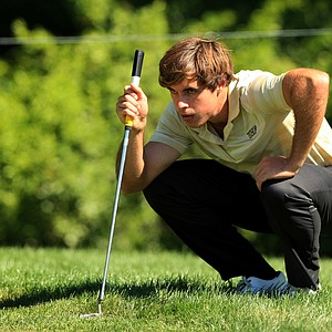 Greg Eason lines up a putt at No. 12 during the Round of 32 at the 2013 U. S. Amateur at The Country Club.