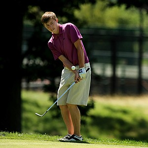 Matt Fitzpatrick chips up to No. 14 during the Round of 32 at the 2013 U. S. Amateur at The Country Club.