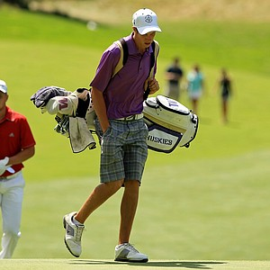 Charlie Hughes is carrying his own bag at the 2013 U. S. Amateur at The Country Club. He advanced to the Round of 16.