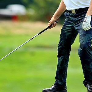 Zac Blair sporting camo pants during the Round of 32 at the 2013 U. S. Amateur at The Country Club.