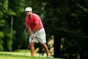 Scott Wolfes watches his shot at No. 14 green during the Round of 32 at the 2013 U. S. Amateur at The Country Club.