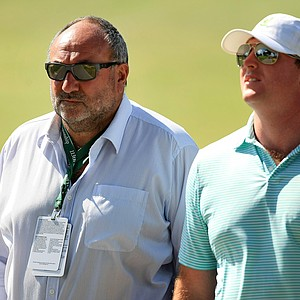 "Andrew ""Chubby"" Chandler of International Sports Management takes in the action during the Round of 16 at the 2013 U. S. Amateur at The Country Club."