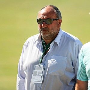 """Andrew """"Chubby"""" Chandler of International Sports Management takes in the action during the Round of 16 at the 2013 U. S. Amateur at The Country Club."""
