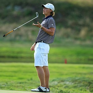 Adam Ball reacts to narrowly missing his putt at No. 10 during the Round of 16 at the 2013 U. S. Amateur.