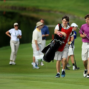 Matt Fitzpatrick walks up No. 13 with his brother/caddie Alex during the Round of 16 at the 2013 U. S. Amateur at The Country Club.