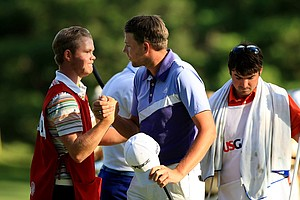 Neil Raymond is congratulated by his caddie Nathan Kimsey during the Round of 16 at the 2013 U. S. Amateur at The Country Club.