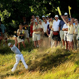 Xander Schauffele attempts to get a shot out of the long grass at No. 15, where he went on to concede the hole and lose the match to Oliver Goss during the Round of 16 at the 2013 U. S. Amateur.