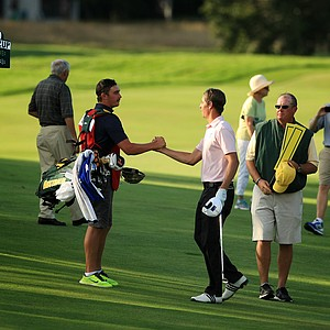Oliver Goss celebrates with his caddie after defeating Xander Schauffele during the Round of 16 at the 2013 U. S. Amateur at The Country Club.