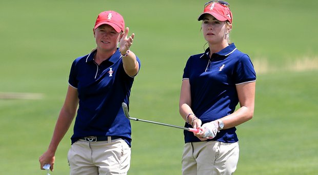 Paula Creamer (right) receives some advice from teammate Stacy Lewis during a practice round at The Colorado Golf Club.