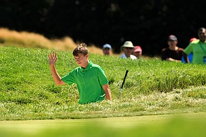 Matt Fitzpatrick holes out from the bunker at No. 2 during the quarterfinals at the 2013 U. S. Amateur at The Country Club.